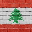Flag of Lebanon on brick wall — Stockfoto