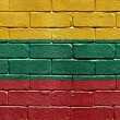 Flag of Lithuania on brick wall — Stok fotoğraf