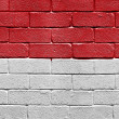 Stock Photo: Flag of Monaco on brick wall