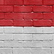 Flag of Monaco on brick wall — Stock Photo