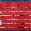 Flag of Nepal on brick wall — Stock Photo #5401711