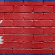 Flag of Nepal on brick wall — Stockfoto