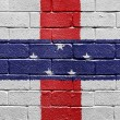 Flag of Netherlands Antilles on brick wall — Stock Photo