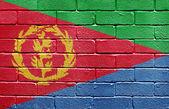 Flag of Eritrea on brick wall — Stock Photo