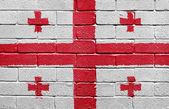 Flag of Georgia on brick wall — Stock Photo