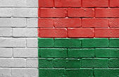 Flag of Madagascar on brick wall — Stock Photo
