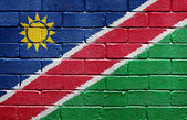 Flag of Namibia on brick wall — Stock Photo