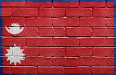 Flag of Nepal on brick wall — Stock Photo