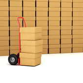 Hand truck with packages — Stockfoto
