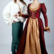 Beautiful pair of medieval costumes — Stock Photo