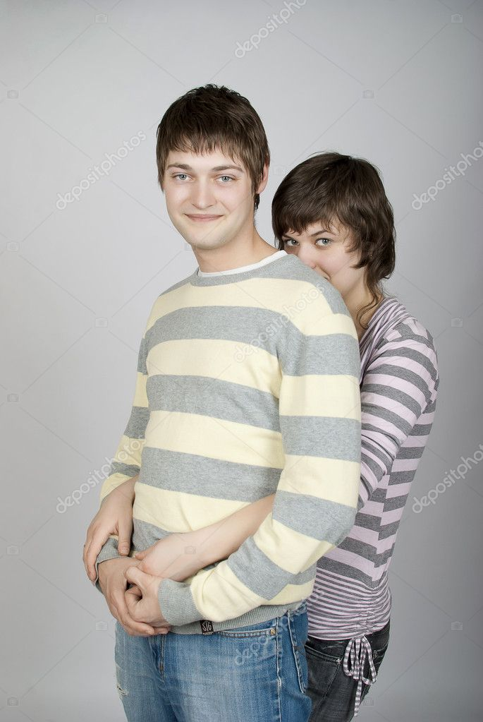 A girl hiding behind her boyfriend — Stock Photo #6142638