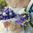 Bridal bouquet and boutonniere groom — Stock Photo