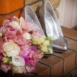 Royalty-Free Stock Photo: Women\'s shoes and flower bouquet