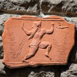 Piece Of Ancient Relief In Terracotta - Stock Photo