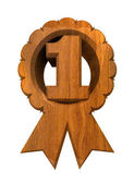 """""""First place"""" decoration cockade in wood — Stock Photo"""