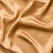 Golden satin or silk background — Stock Photo