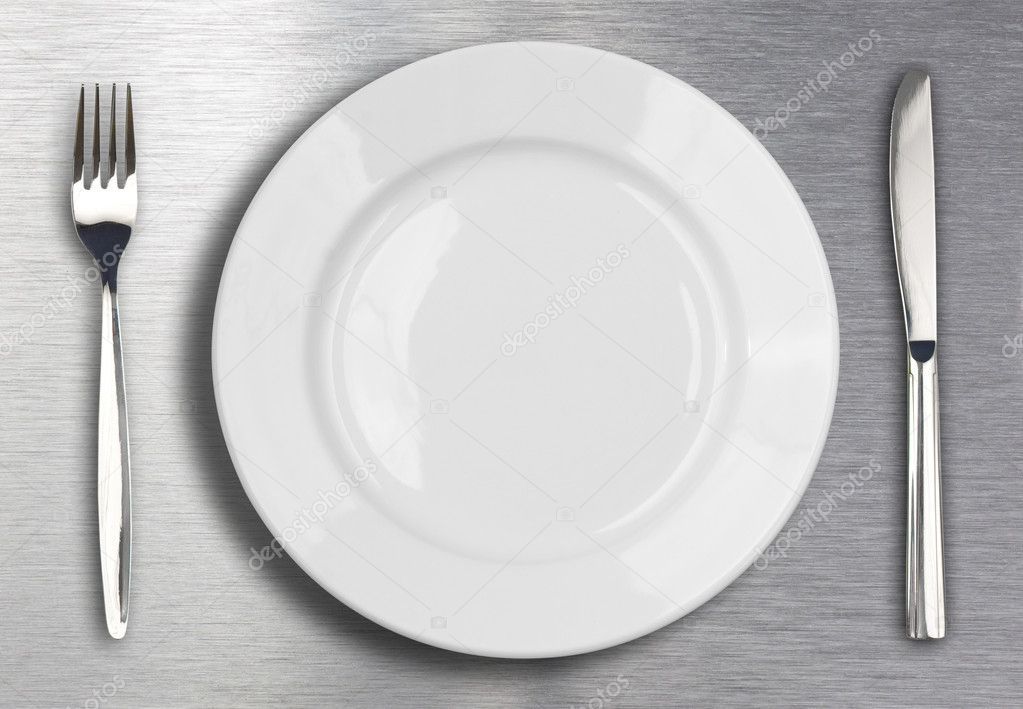 Knife, white plate and fork on metal background — Photo #6004217