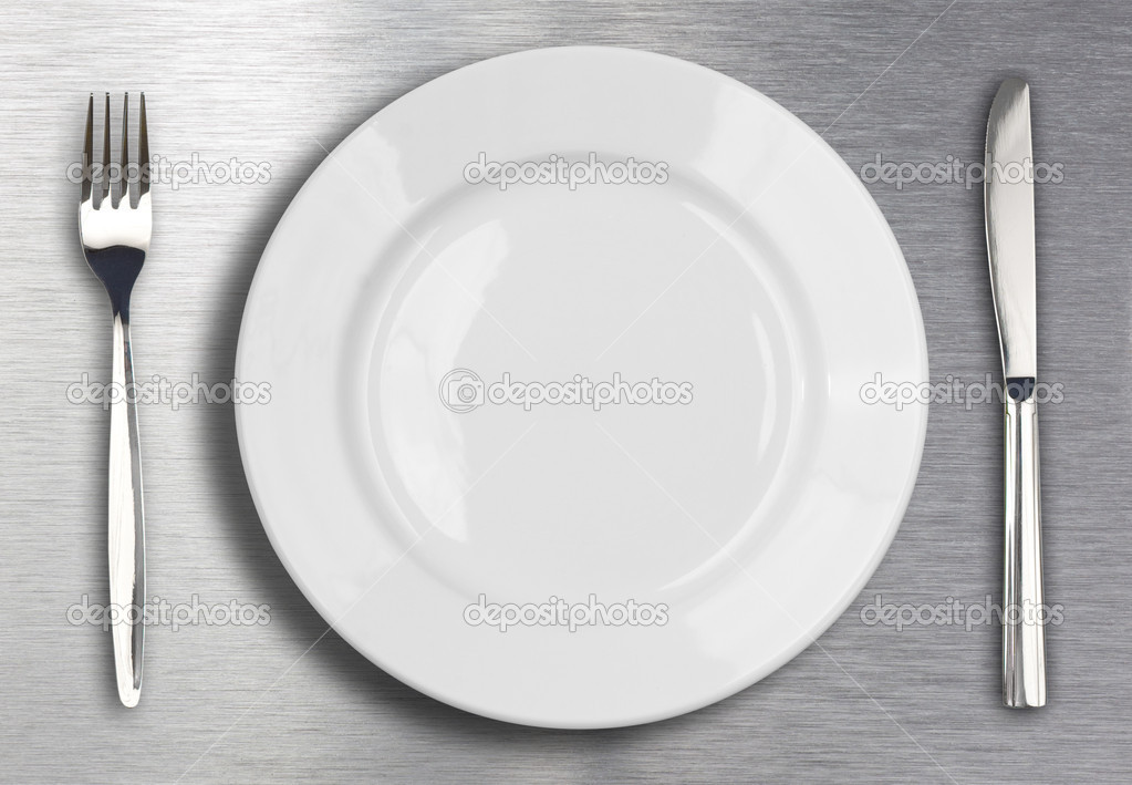 Knife, white plate and fork on metal background — Stok fotoğraf #6004217