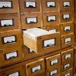 Stock Photo: Database concept. vintage cabinet. library card or file catalog.