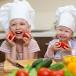 Stock Photo: Two little girls preparing healthy food on kitchen