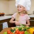 Little girl preparing healthy food on kitchen — Stock Photo