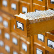 Database concept. vintage cabinet. library card or file catalog. - Stok fotoğraf