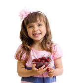 Little girl with cherry berries bowl in studio isolated — Stock Photo