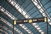 Terminal 1 and 2 signs in airport interior — Stock Photo