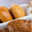Assortment of small breads in basket - Stock Photo