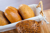 Assortment of small breads in basket — Stock Photo