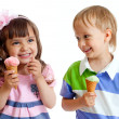 Happy children twins girl and boy with ice cream in studio isola — Stock Photo