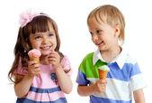 Happy children twins girl and boy with ice cream in studio isola — Stock Photo