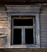 Black Window burned house — Stock Photo