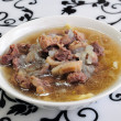 Homemade noodles with slices of lamb and soup, Mongolian cuisine - Stock Photo
