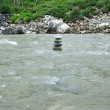 Cairn on the river — 图库照片