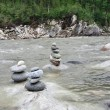 Cairn on the river — Stock Photo