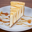 Caramel Drizzled Cheesecake on Plate — Stock Photo #5560312