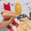 Picking Up A 4th Of July Hotdog — Stock Photo
