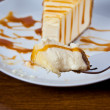 Caramel Drizzled Cheesecake on a Plate — Stock Photo