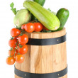 Wooden barrel with vegetables isolated — Stock Photo