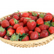 Strawberry in wicker bowl — Stock Photo