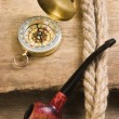 Compass and a pipe with a rope — Stock Photo