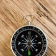 Stock Photo: Compass on background of wooden planks