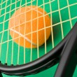 Tennis racket and a ball — Stock Photo