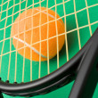 Stock Photo: Tennis racket and a ball