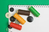 Thread with a needle and buttons — Stock Photo