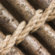 Стоковое фото: Strips of wood bound with rope