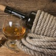 Bottle of wine wrapped with rope — Stock Photo