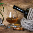 Bottle of wine wrapped with rope — Stock Photo #5464192