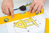 Drawing at home with construction tools — Stockfoto